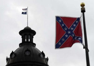 A Confederate flag is displayed at the South Carolina state capitol in Columbia January 9, 2008. Many U.S. presidential campaigns shift their focus to South Carolina today for their first test in the south--the historic flag, which until 2000 flew from the capitol dome, is for some a symbol of the state's political and racial divisions.  REUTERS/Jonathan Ernst   (UNITED STATES) - RTX5DUD